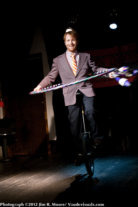 Kyle Peterson juggles in the Loose Caboose Variety Show