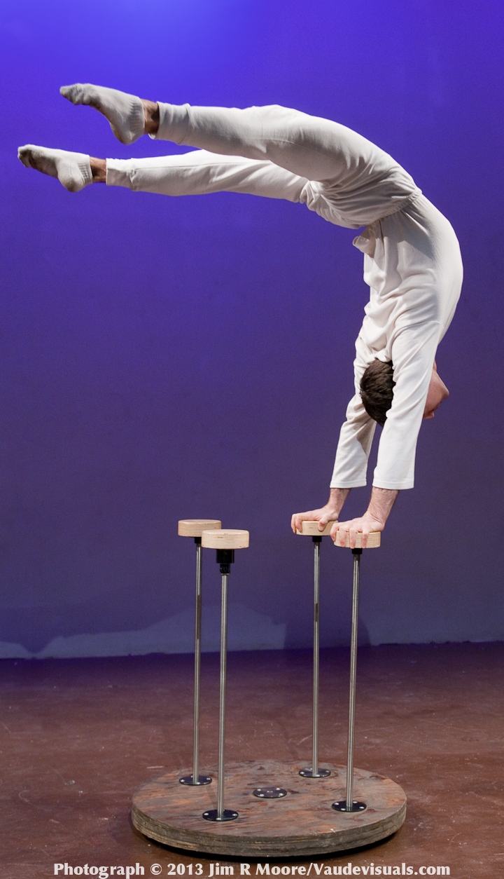 Yuval Oz performs miracles in hand balancing.