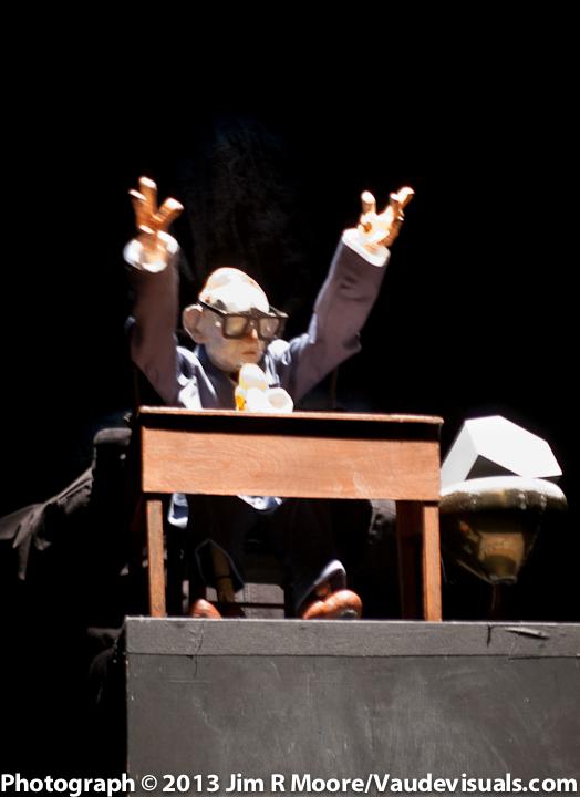 James Godwin performs a 'bunraku' style puppet piece.