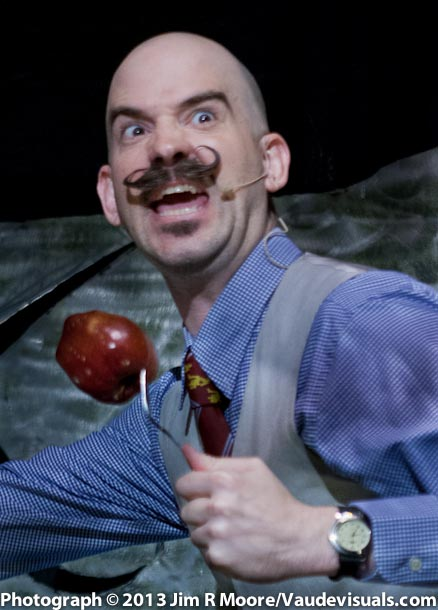 Donny Vomit tries his hand at juggling machete knives and an apple.