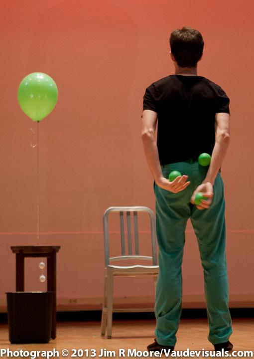 Michael Karas juggles 2 balls behind his back at JUGGLE THIS