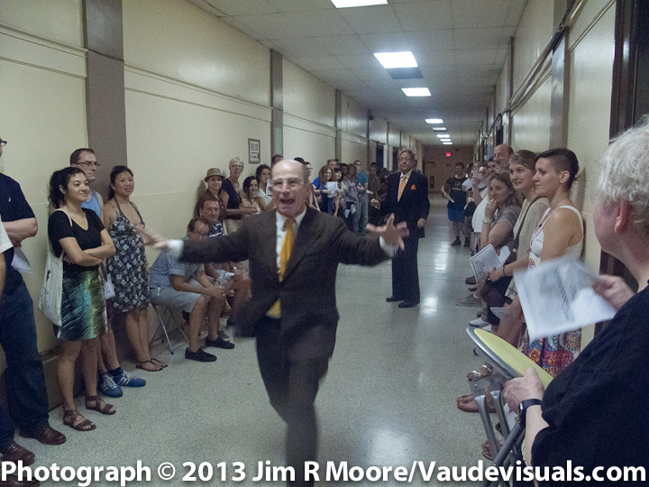 Everett Quinton running down the hall during the performance of MANNA-HATA