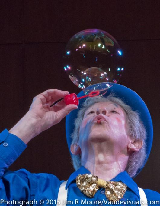 John Grimaldi blowing bubbles.