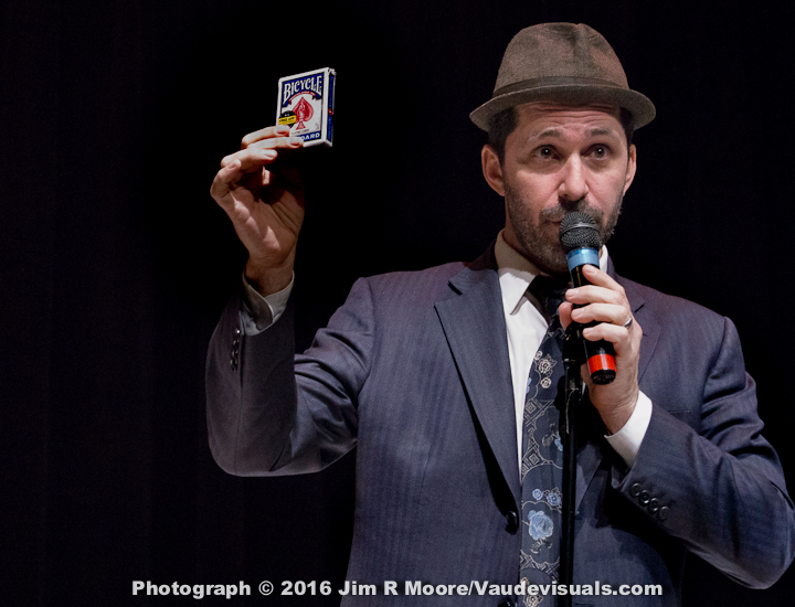 Greg Dubin performs a magic trick with cards.