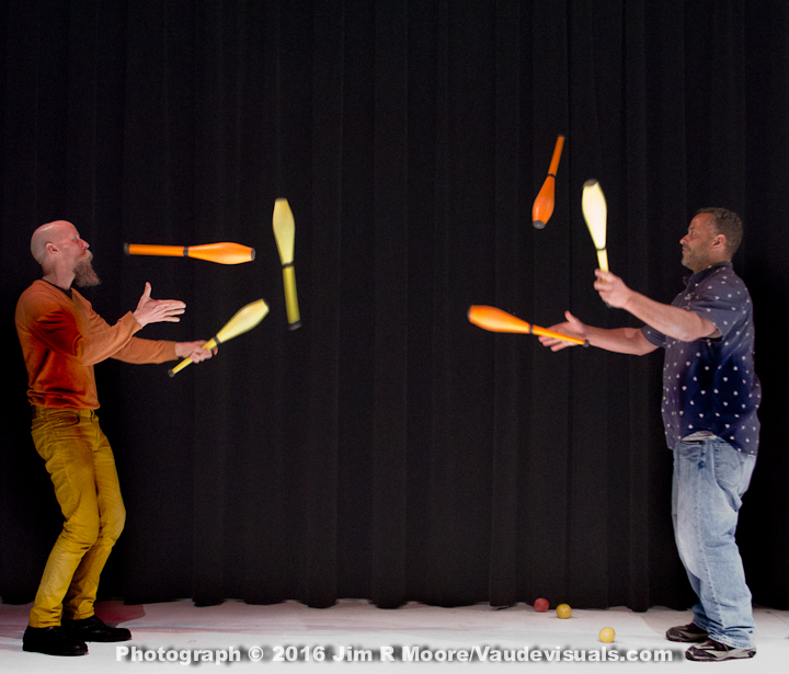 Dropsy Twins juggling clubs.